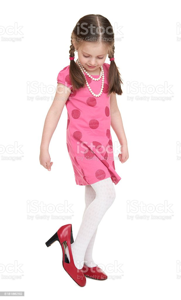 Girl child in red look on shoes with high heels stock photo