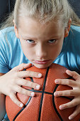 Girl child with basketball, portrait.