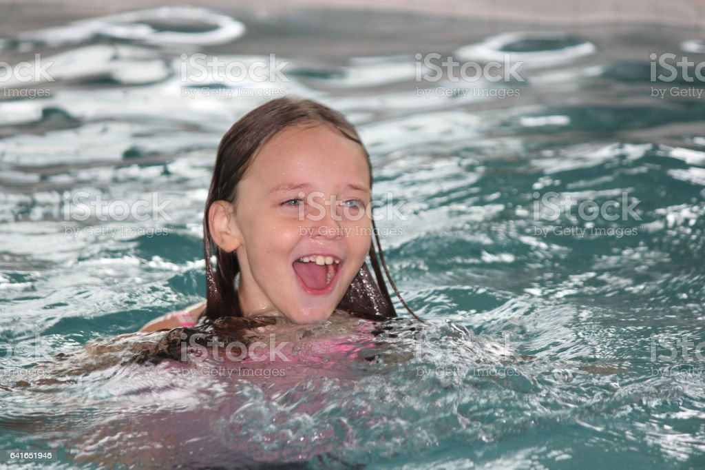 Girl Child-in Pool stock photo