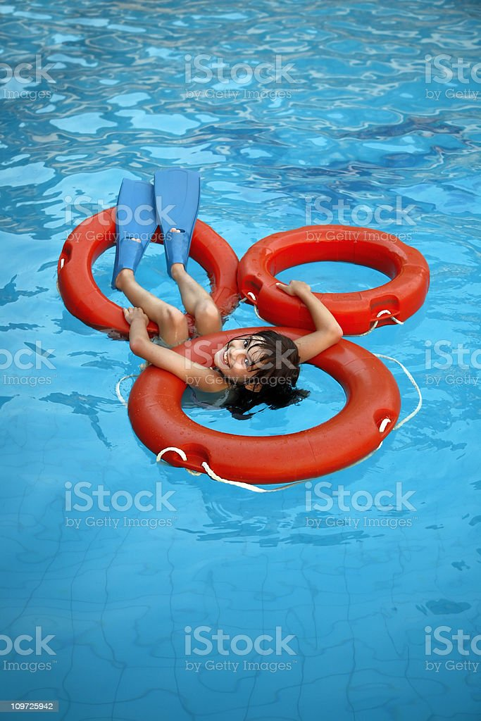 Girl chilling out in the pool royalty-free stock photo