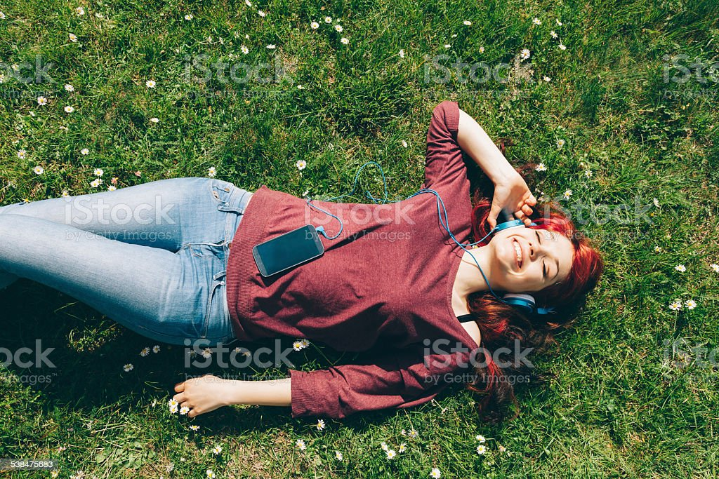 Girl chilling out with relaxing music stock photo