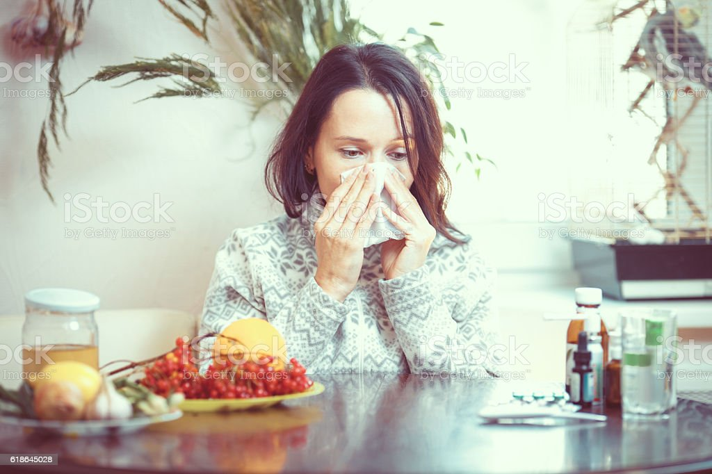 Girl chooses between pills and fruits stock photo