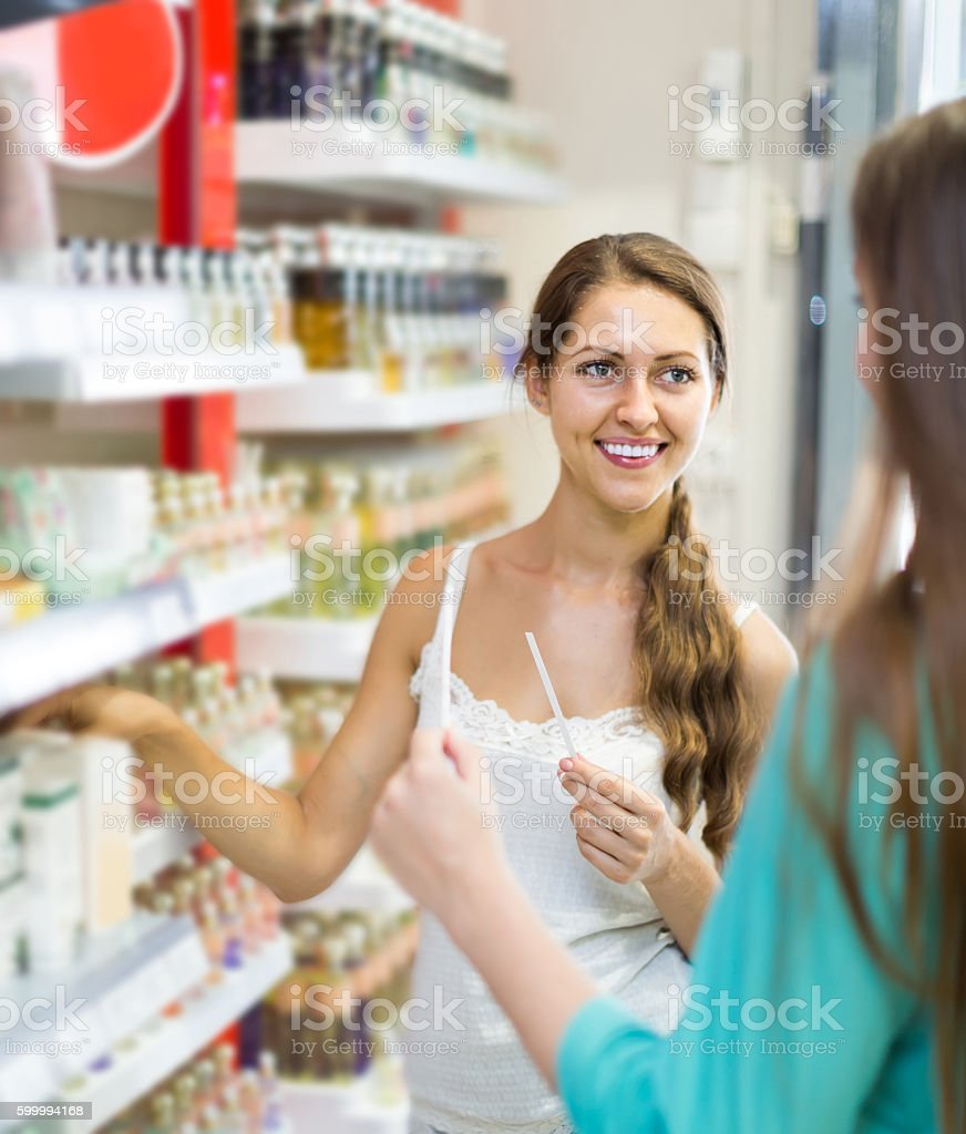 girl chooses perfume in the shop stock photo