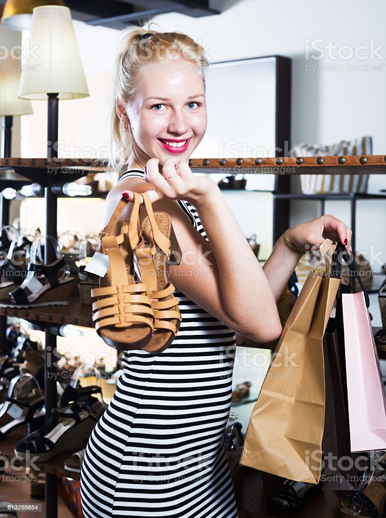 girl chosing pair of shoes stock photo