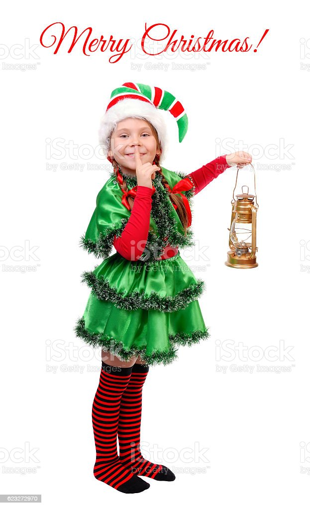 Girl Christmas elf with oil lamp over white stock photo