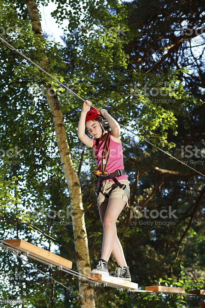 Girl climbing in adventure park royalty-free stock photo