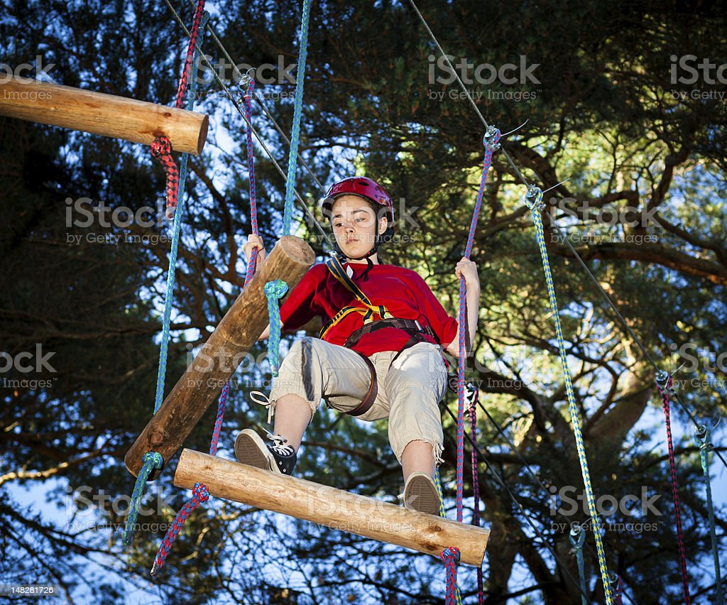 Girl climbing in adventure park royalty-free stock photo