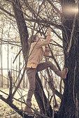 Girl climbing on the tree.