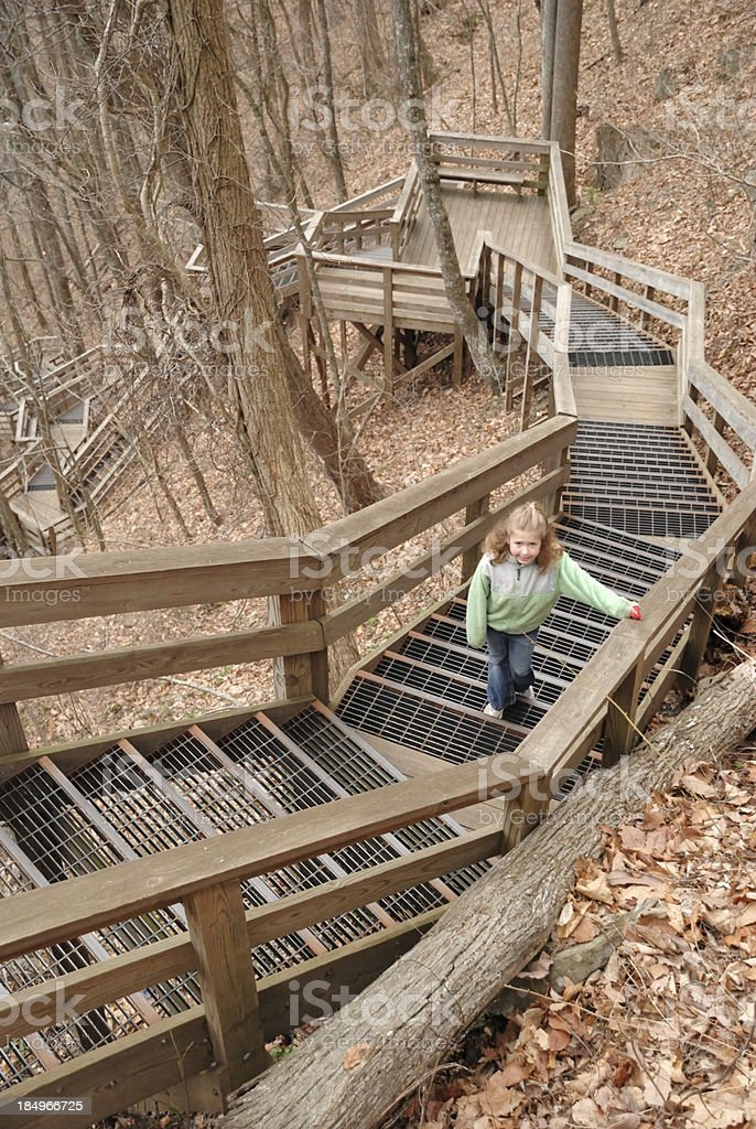 Girl climbing outdoor stairs royalty-free stock photo