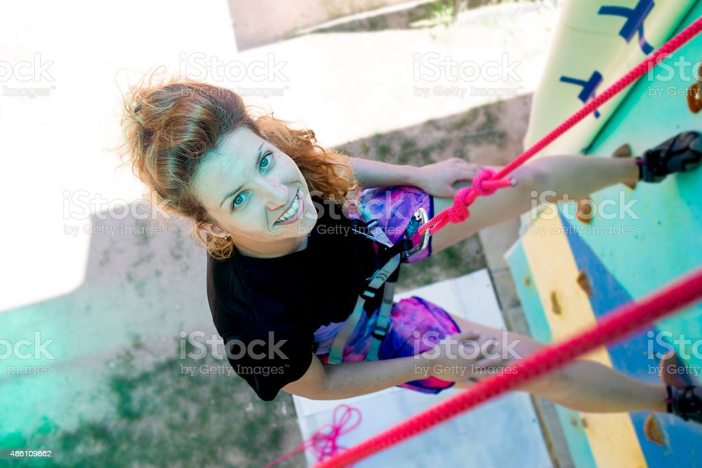 Girl climbing stock photo