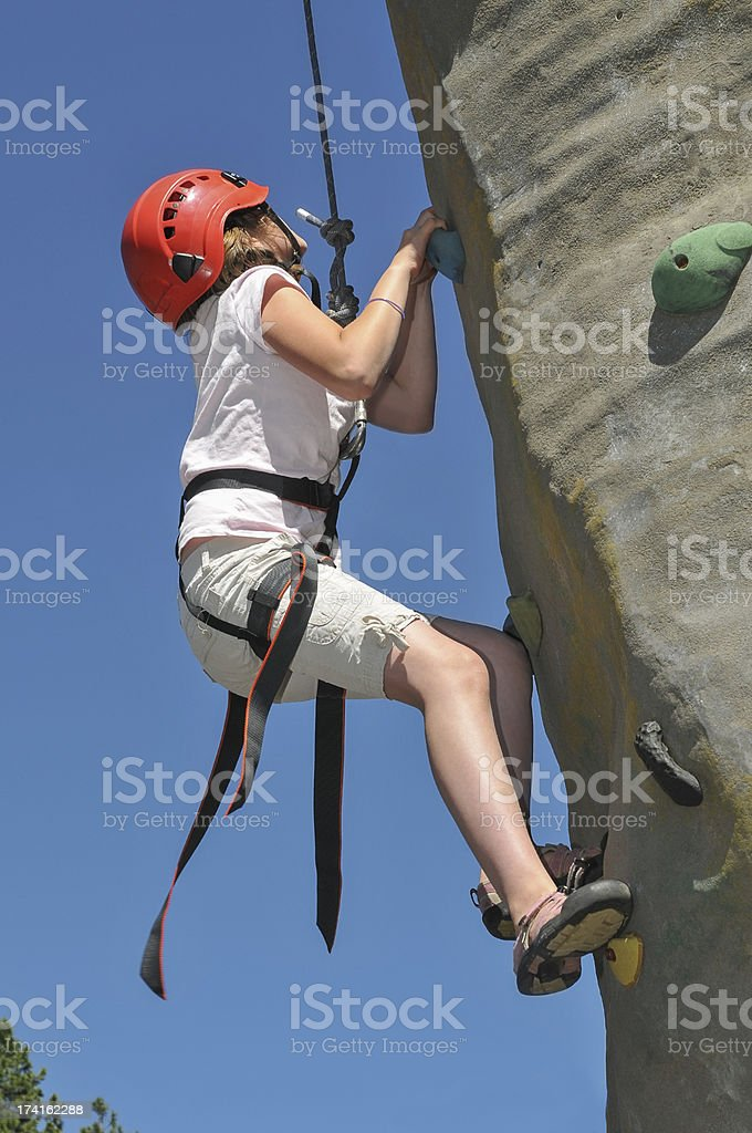 Girl Climbing Rock Wall royalty-free stock photo
