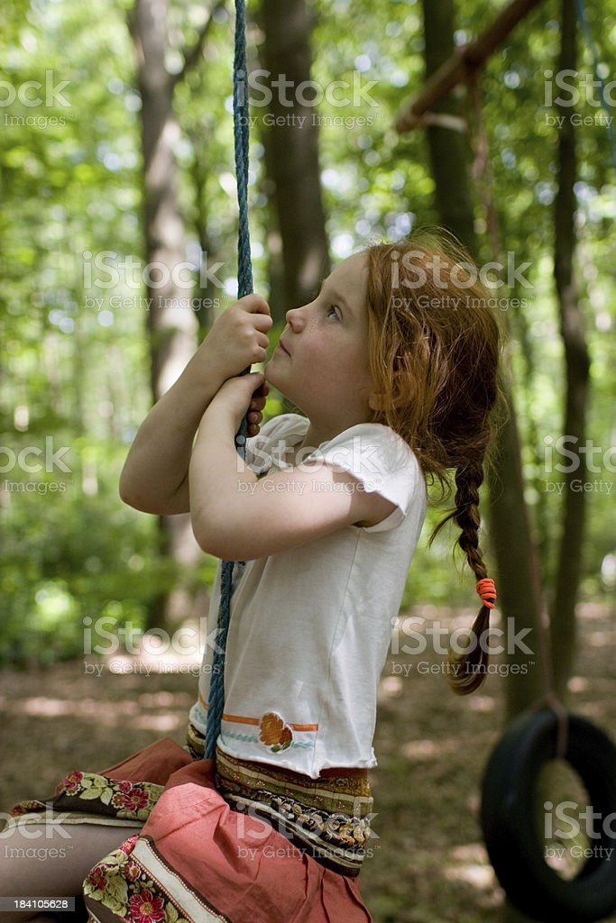 girl, climbing up a rope royalty-free stock photo