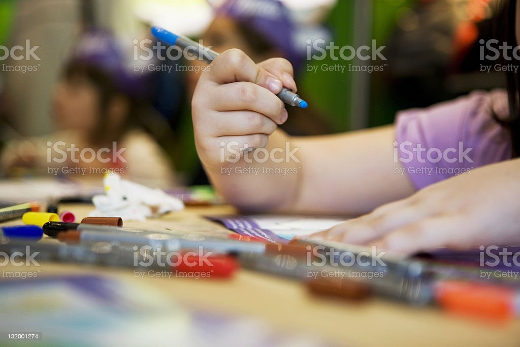 Girl coloring stock photo