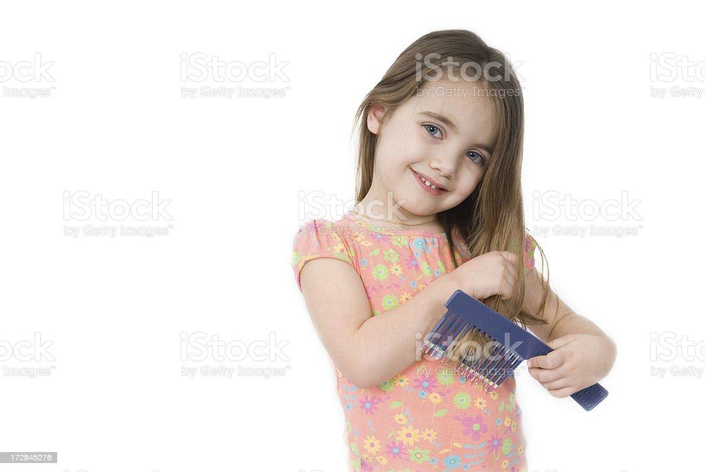 Girl combing hair royalty-free stock photo