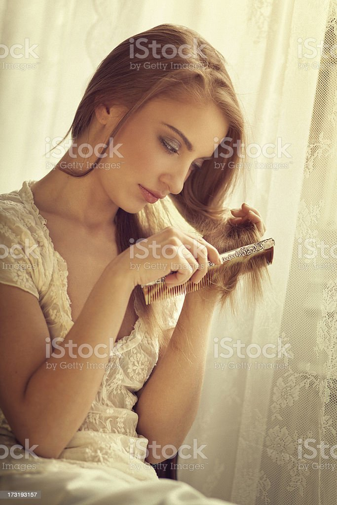 girl combing her hair royalty-free stock photo