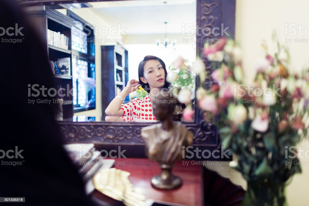 girl combing her long hair stock photo