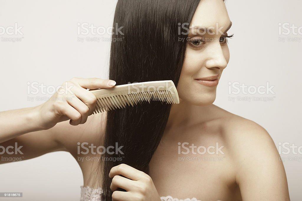 girl combs hair royalty-free stock photo