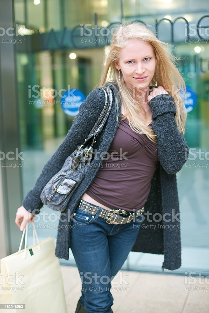 Girl coming from shopping stock photo