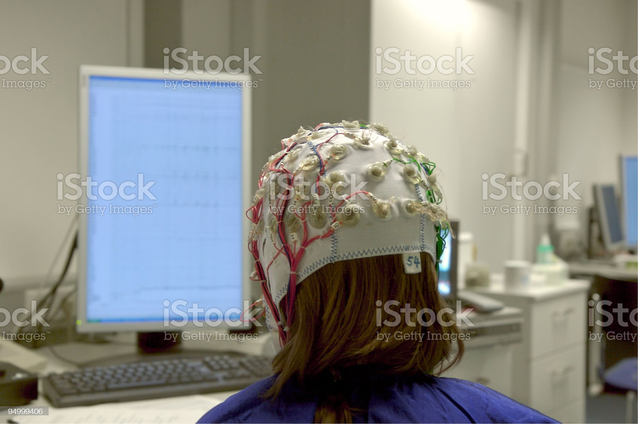 girl connected with cables for EEG in front of screen royalty-free stock photo