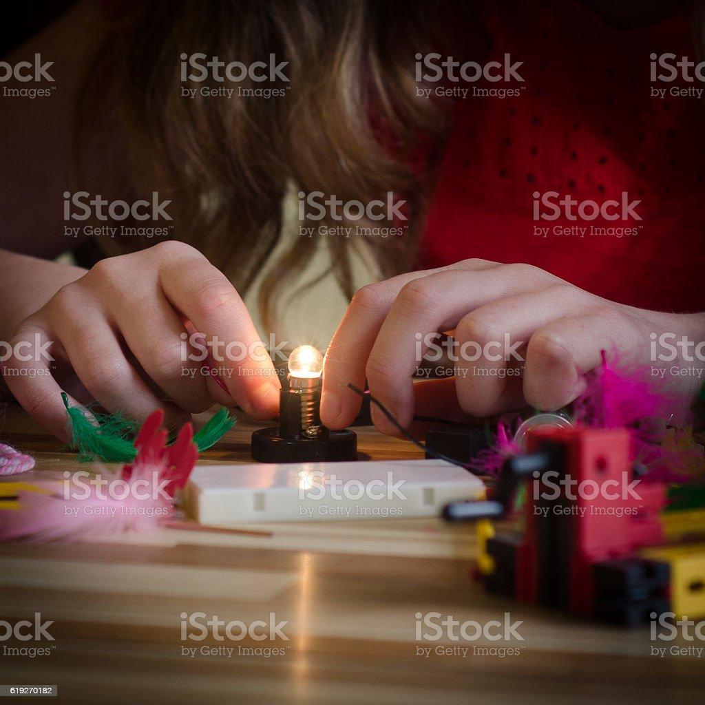 Girl Connects Lightbulb stock photo