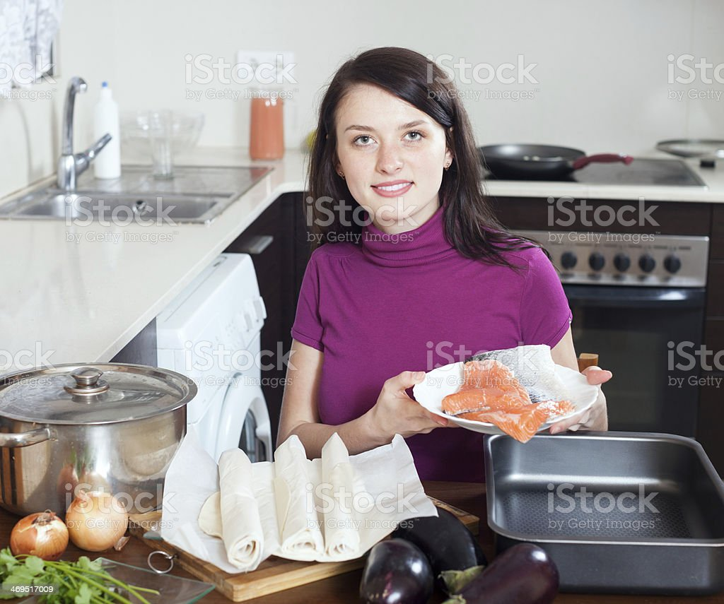 girl cooking fish pie with  salmon stock photo