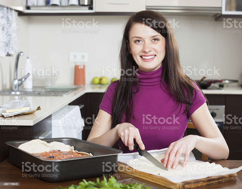girl cooking  pie with store-bought dough stock photo