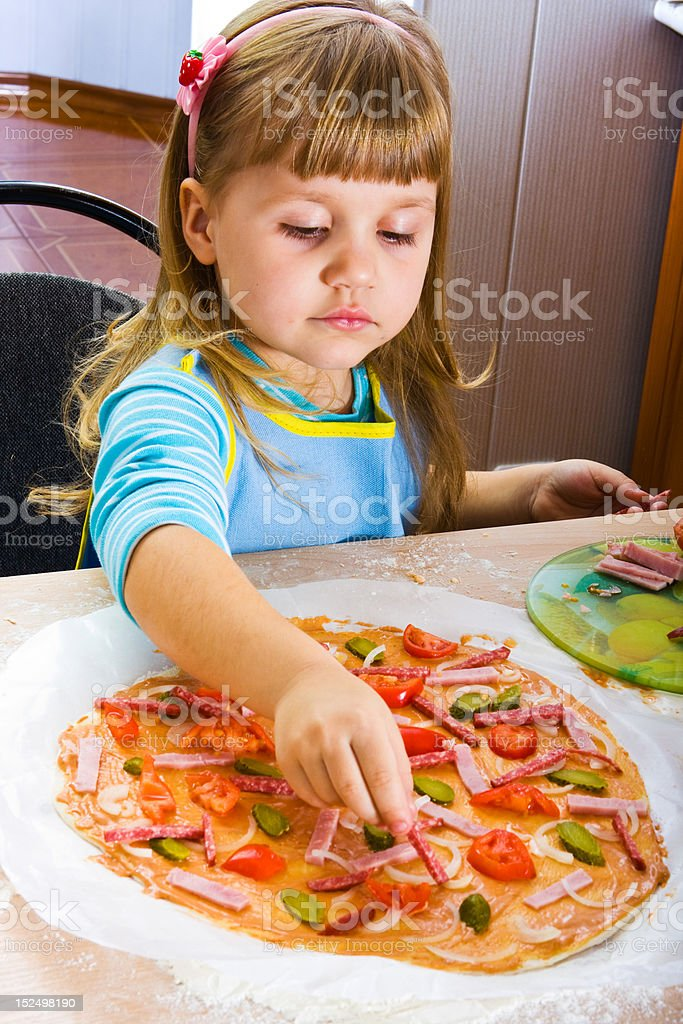 Girl cooking pizza royalty-free stock photo
