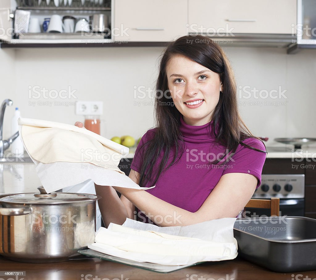Girl cooking with prepared shop-bought dough stock photo