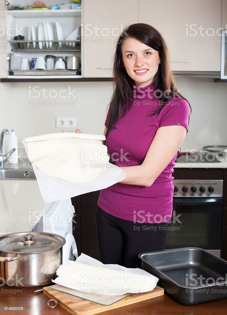 Girl cooking with prepared store-bought dough stock photo
