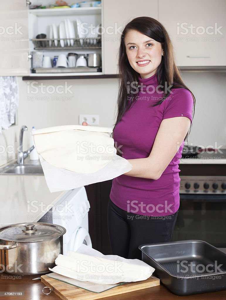 Girl cooking with  shop-bought dough stock photo