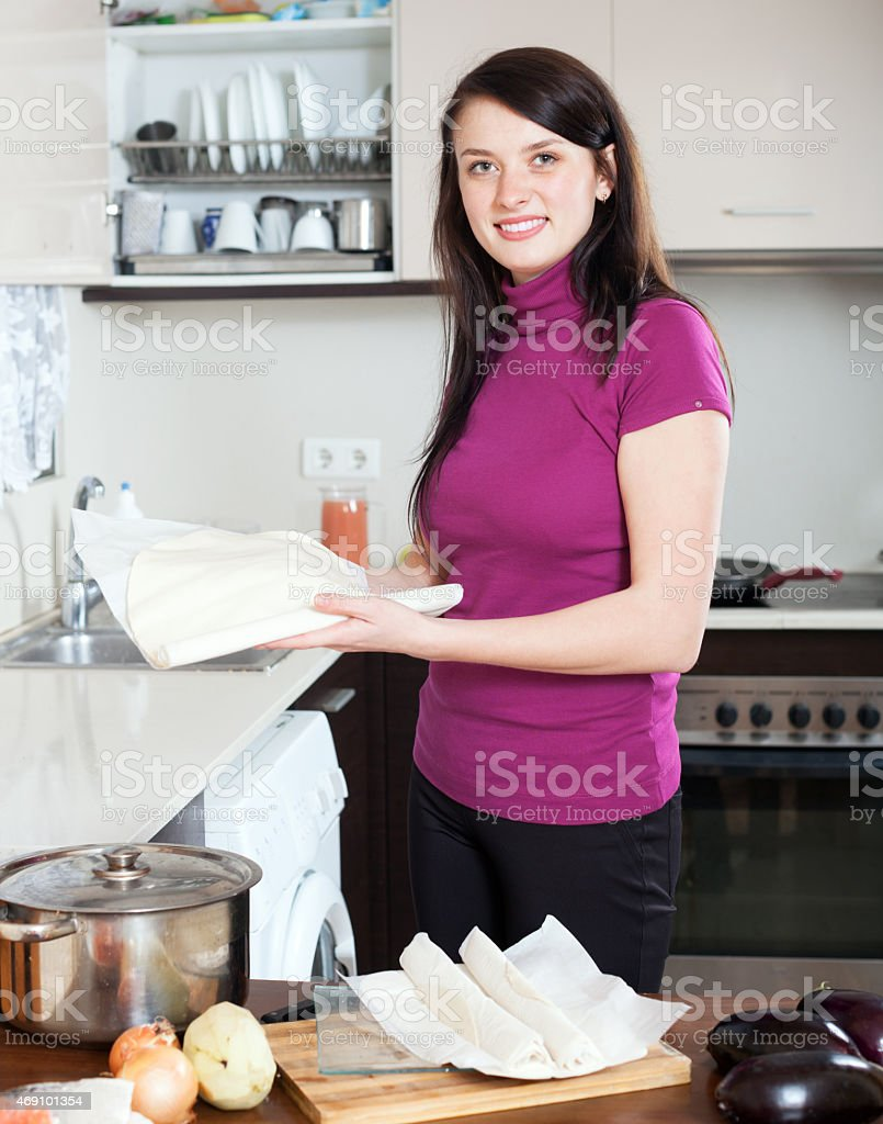 girl cooking with store-bought dough stock photo