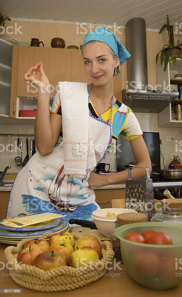 Girl cooks in the kitchen royalty-free stock photo