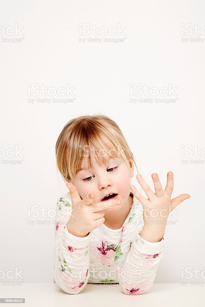 Girl counting fingers stock photo