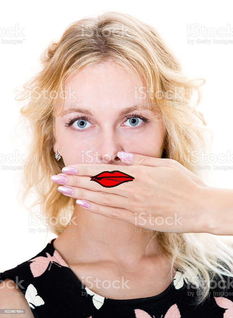 Girl cover her mouth with hand. stock photo