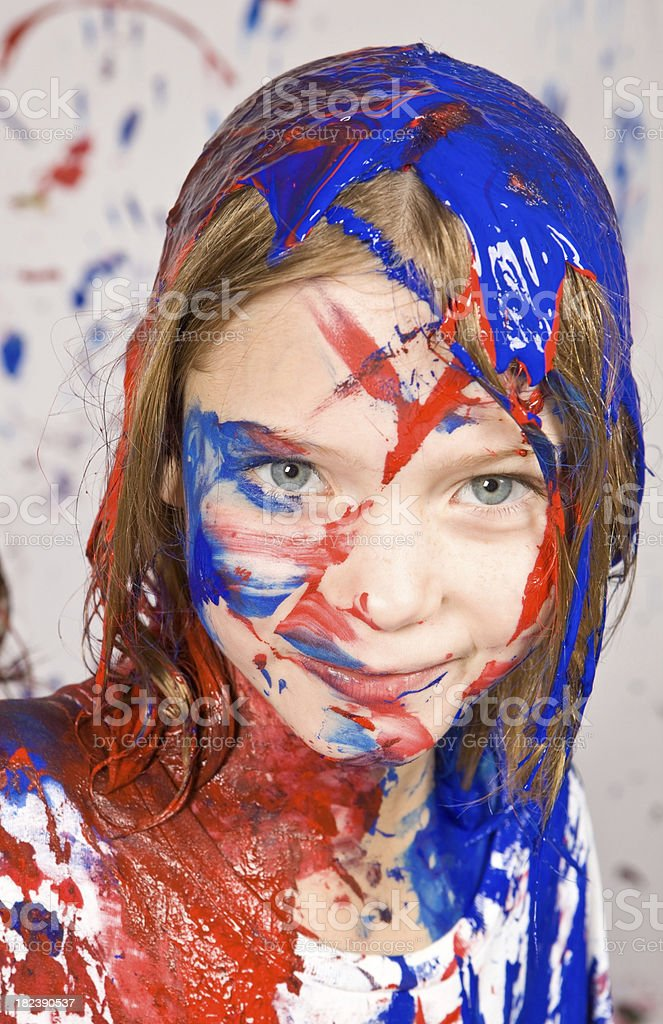 Girl Covered with Red and Blue Paint royalty-free stock photo