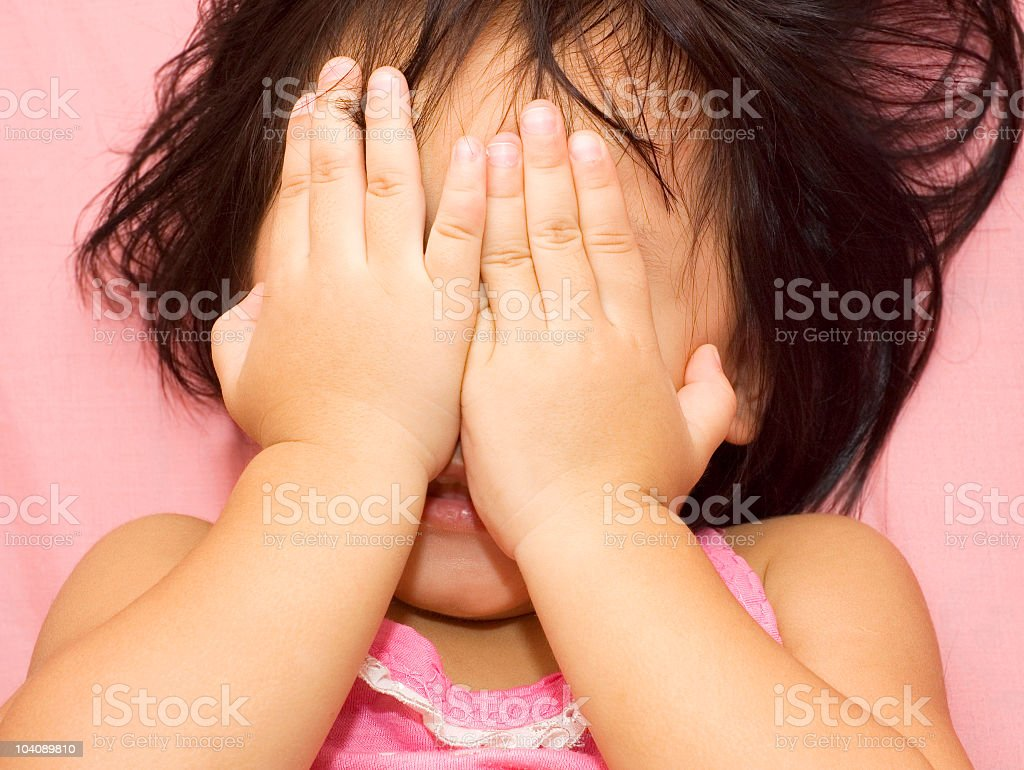 girl covering face stock photo