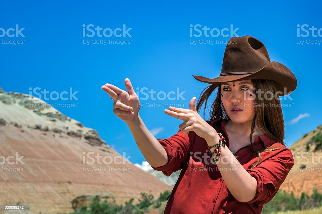 girl cowboy holds his fingers like a gun stock photo