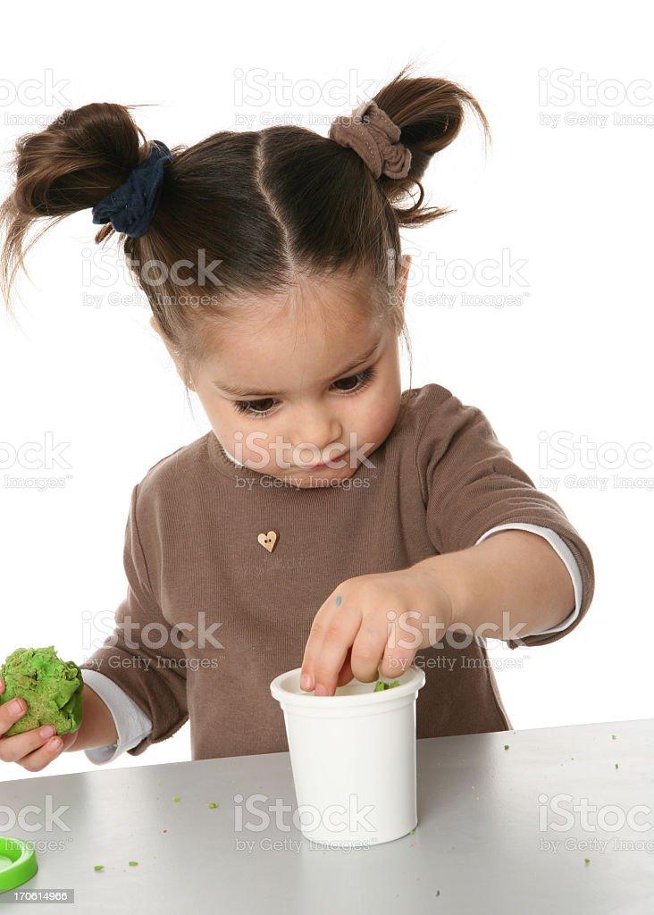 girl creating with plasticine stock photo