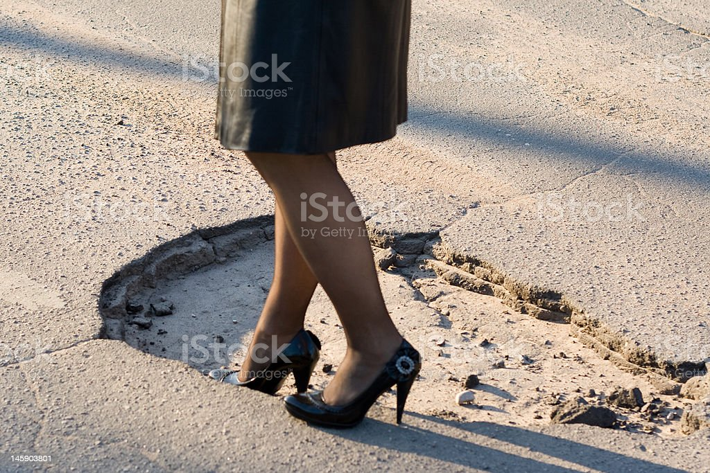 Girl crossing huge hole. royalty-free stock photo