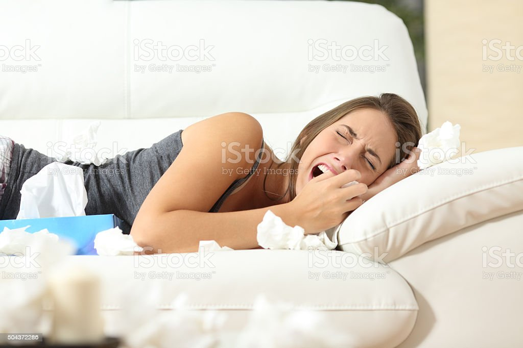 Girl crying desperately at home stock photo