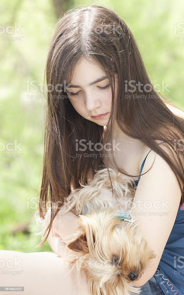 Girl crying while holding her sick dog royalty-free stock photo