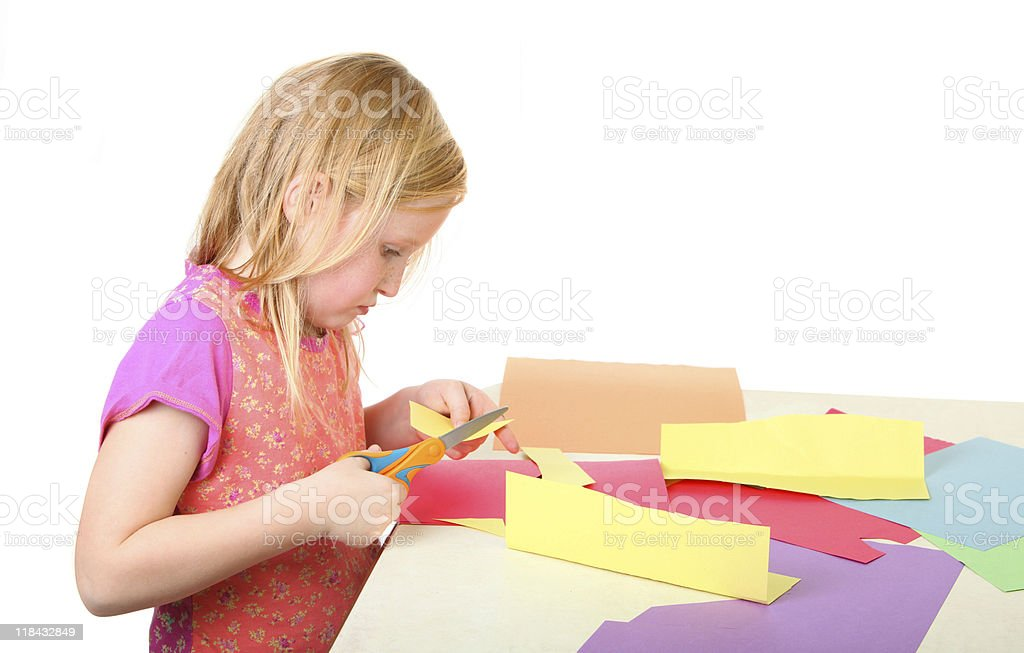 girl cutting paper stock photo