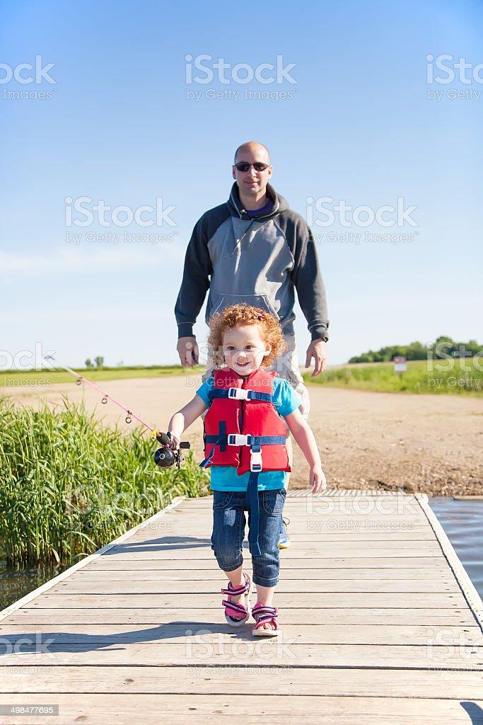 Girl & Dad Walking on Dock Going Fishing royalty-free stock photo