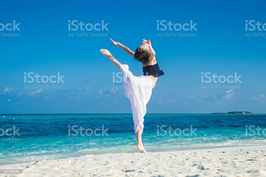 girl dance at tropical beach stock photo