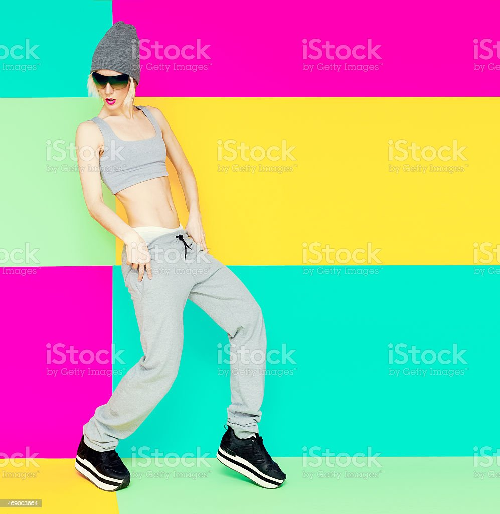 girl dancer on bright background. Lifestyle, Sports clothes, fas stock photo
