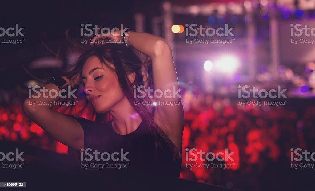 Girl dancing at concert stock photo