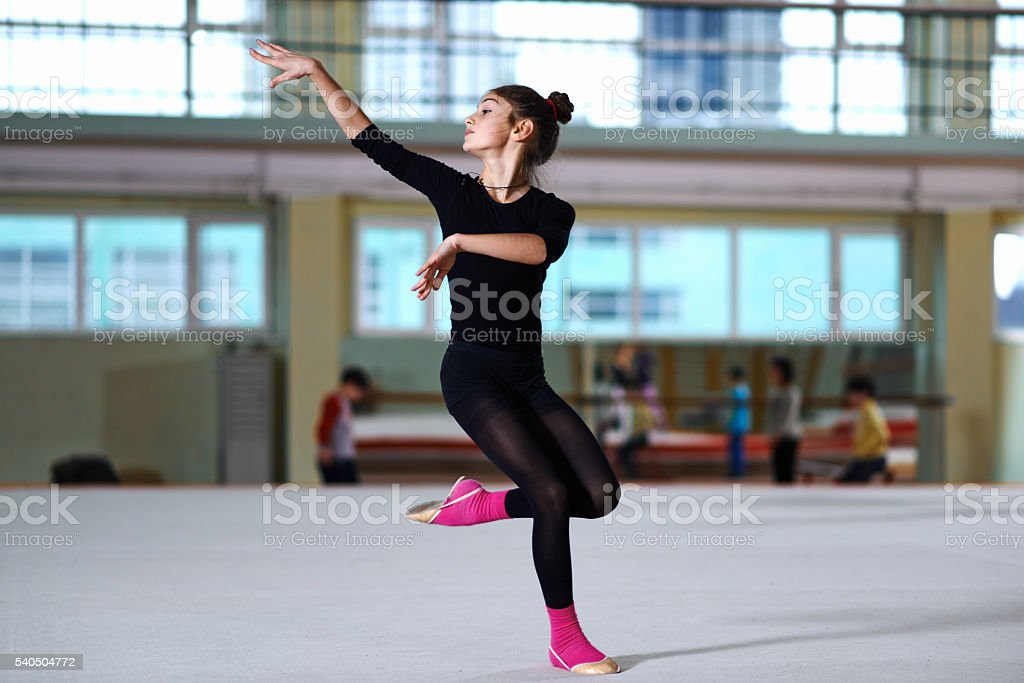 girl dancing on training  rhythmic gymnastics stock photo