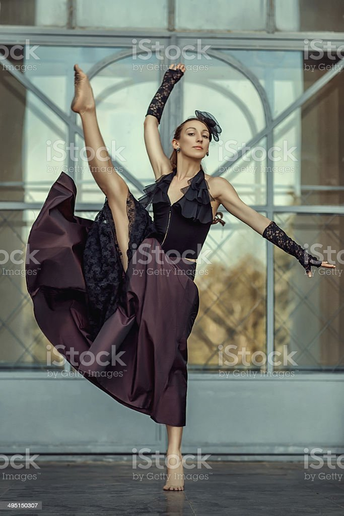 Girl dancing with a raised foot high. royalty-free stock photo