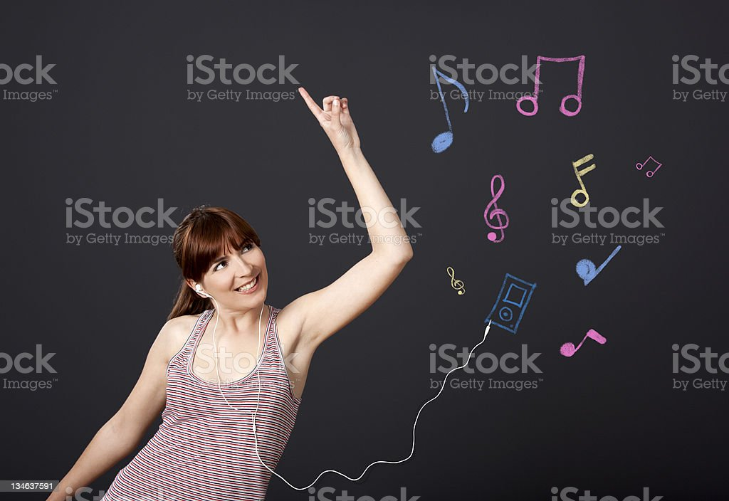 Girl dancing with musical notes royalty-free stock photo