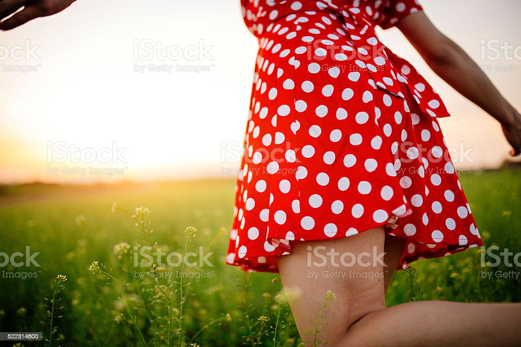 Girl dancing with the sun stock photo